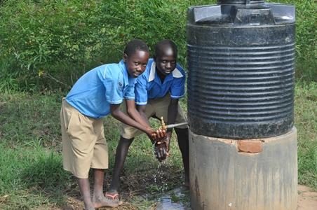 Emmanuel at a water tank