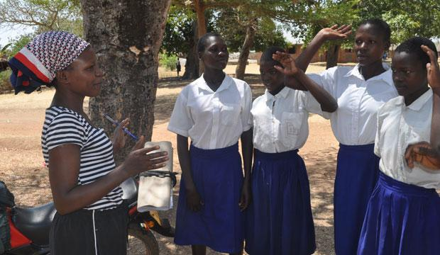 A Build Africa staff member meets with a group of girls