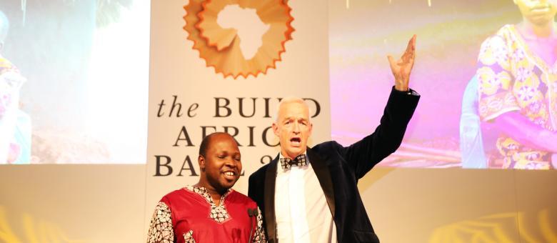 Channel 4 News host Jon Snow joins Build Africa's Anslem Wandega for a duet