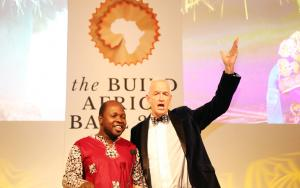 Channel 4 News host Jon Snow joins Build Africa's Anslem Wandega for a duet